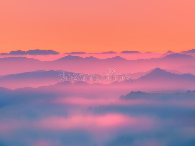 Misty mountains silhouettes royalty free stock image