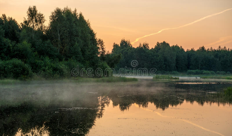 Misty orange lake royalty free stock photography