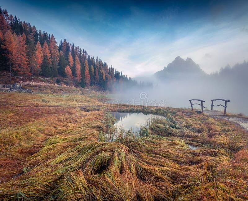 Misty outdoor scene on Antorno lake. Colorful autumn morning in Dolomite Alps, National Park Tre Cime di Lavaredo, Italy, Europe. stock photo