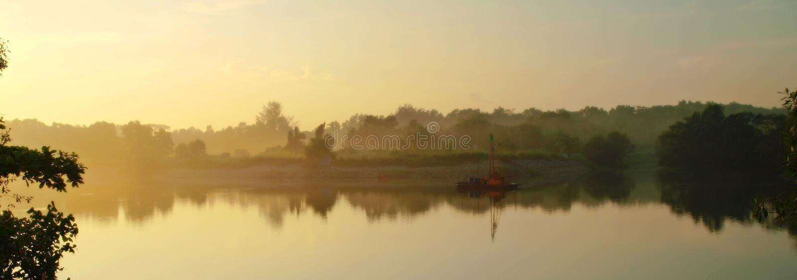 Misty River. Scenery with dredging works in progress stock image