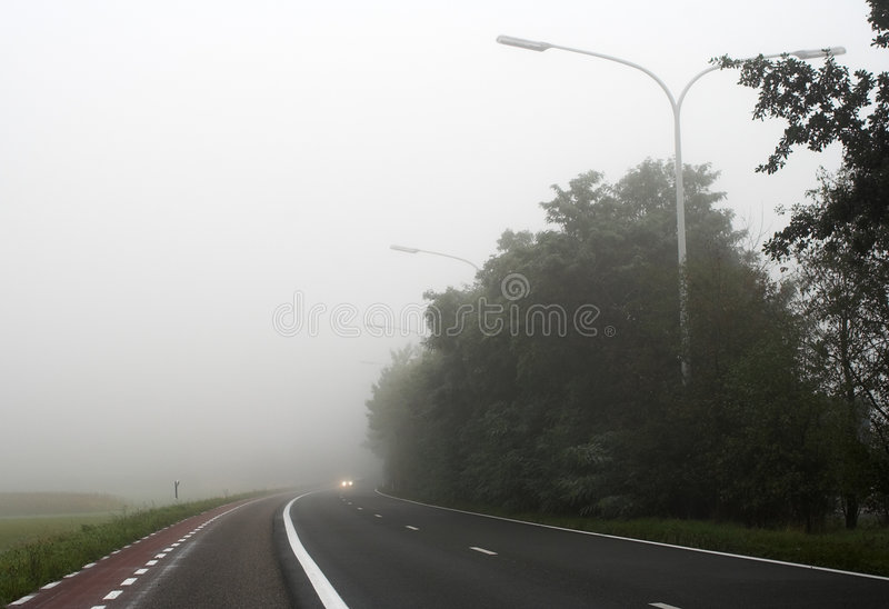 Download Misty Road With Car Headlights Far Away Stock Photo - Image: 493594
