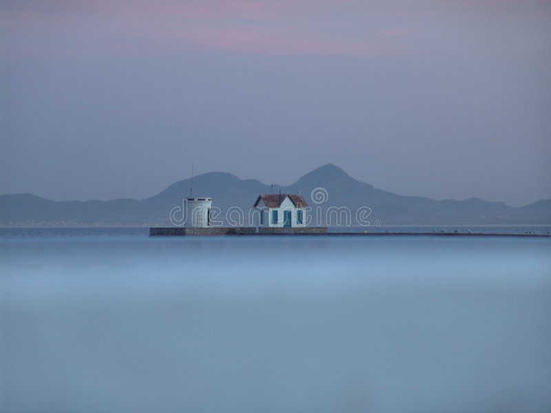 Misty Sea, Pier and Mountains royalty free stock photography