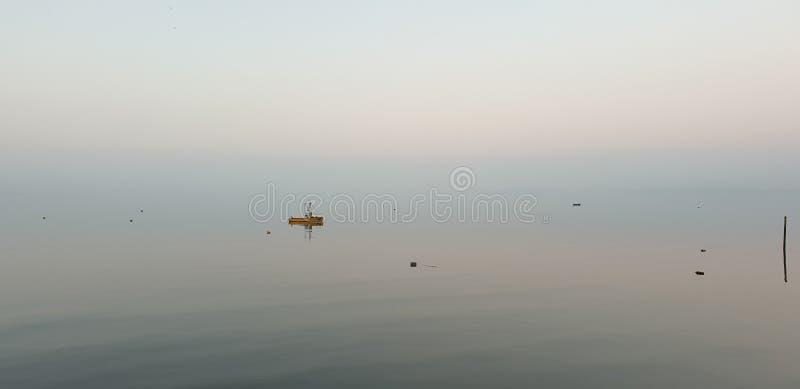 Single boat at Morecambe Bay stock images