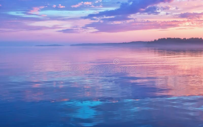 Misty Lilac Sunset Seascape With Sky Reflection stock images