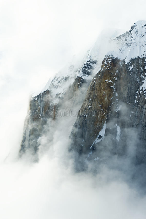 Misty snow covered mountain royalty free stock image
