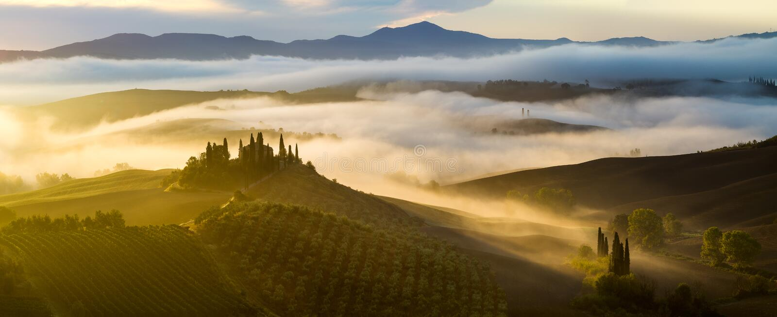 Misty, sunny morning in Tuscany royalty free stock photo