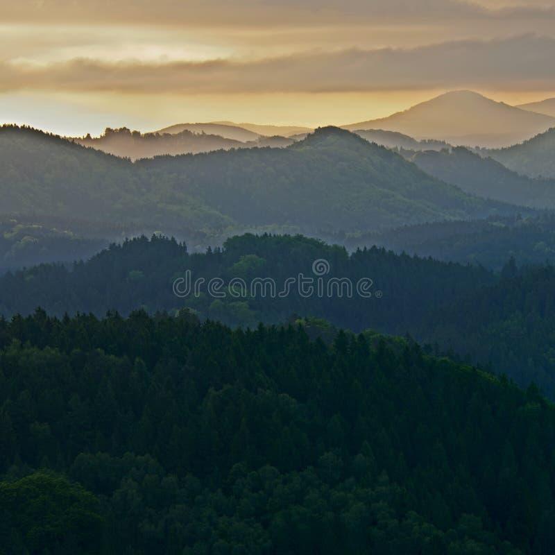 Misty Sunrise. Sunrise in a beautiful mountain of Czech-Saxony Switzerland, panoramic photo royalty free stock photography
