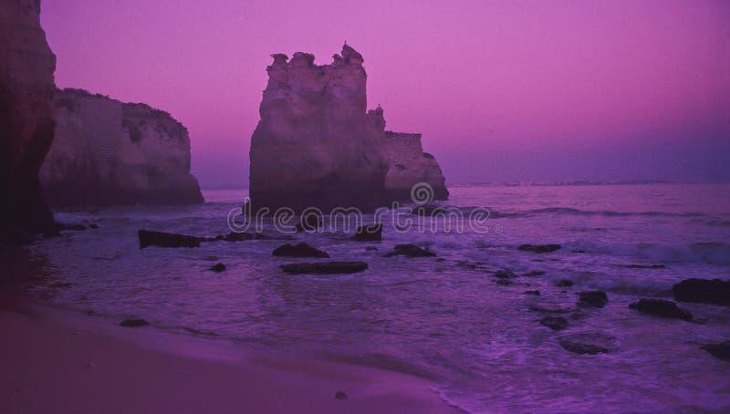 Misty sunrise on the beach stock photography