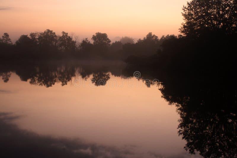 Misty sunrise morning lake