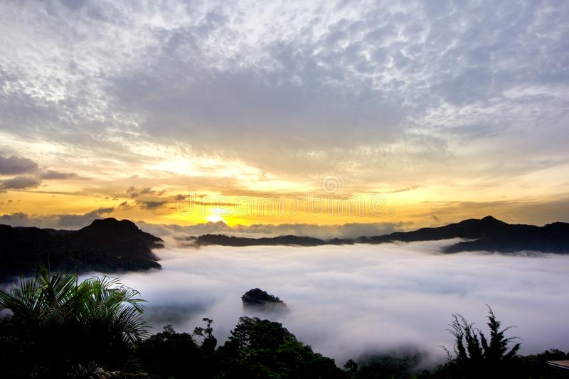 Misty sunrise over mountain with dramatic cloud and sky. In the morning at Phu Langka in Phayao province, Thailand royalty free stock photography