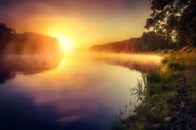 Misty sunrise over the river. Yellow misty sunrise over the river Neris, Lithuania