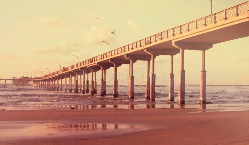 Misty sunrise pier