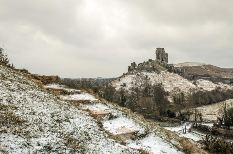 Corfe Castle in Dorset during a winters snowy morning stock image