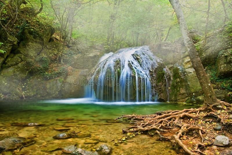 Misty waterfall. On a mountain river stock images