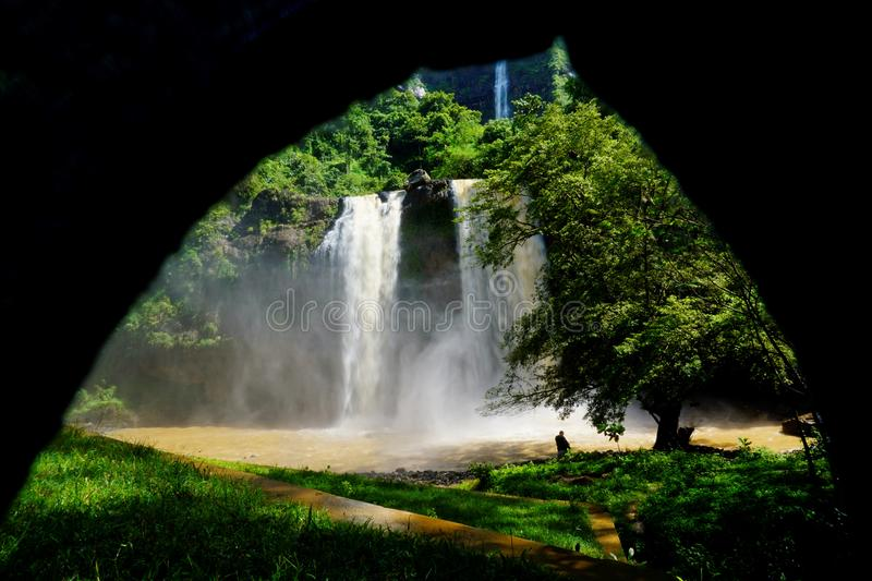 Misty waterfall captured in framing. With water pool under the waterfall stock images