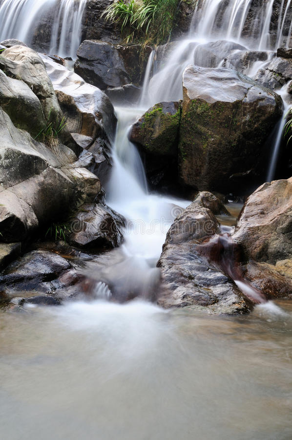 Misty waterfall. In a mountainous area in Guangxi, China stock image