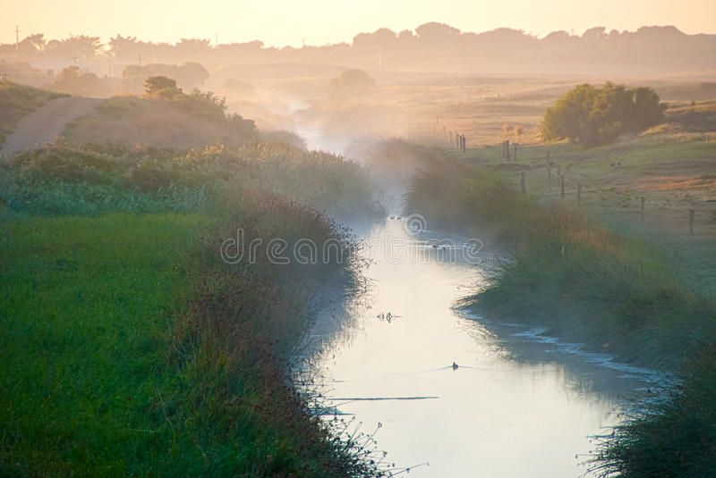 Misty waterway royalty free stock image
