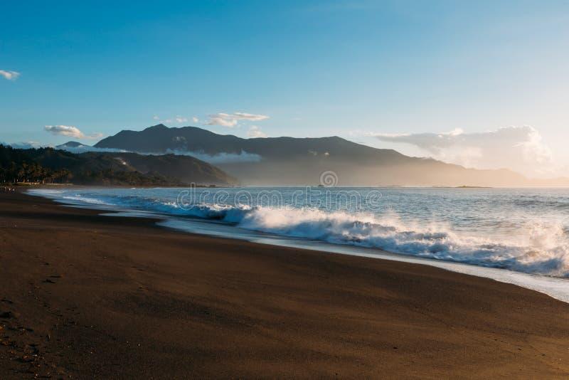 Misty Waves along the shore at dusk stock photos