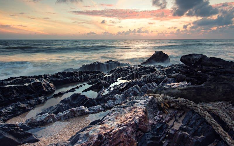 Misty waves sunrise stock photo