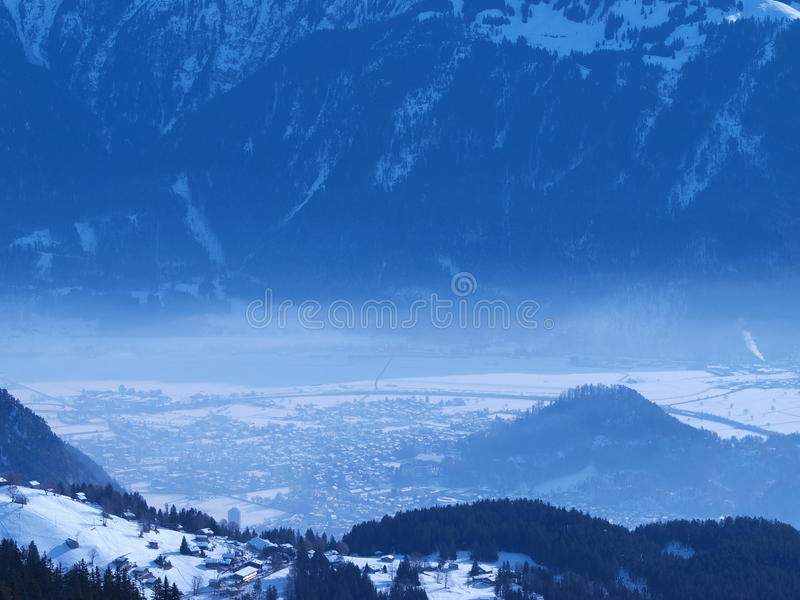 Misty Winter Landscape. An aerial view of a winter landscape in the Swiss Alps stock images