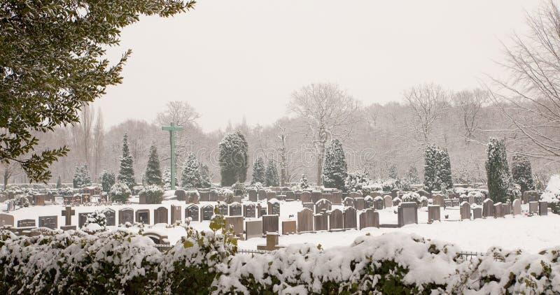Misty winter morning graveyard royalty free stock photo