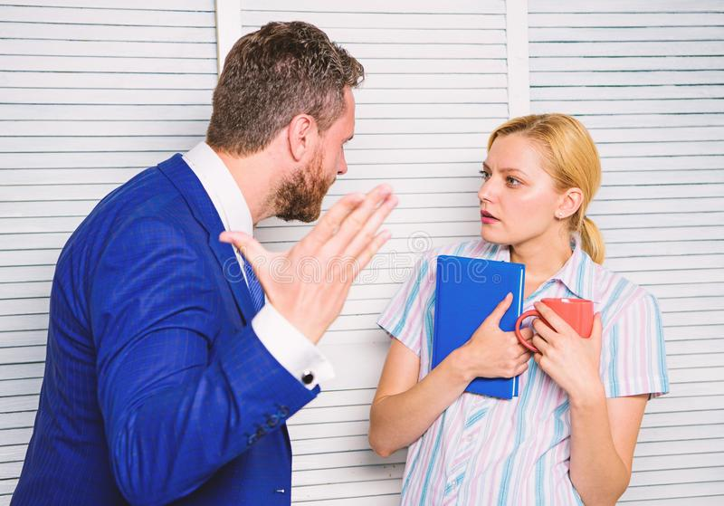 Misunderstanding between colleagues. Prejudice and personal attitude to employee. Tense conversation or quarrel between. Colleagues. Boss and worker discuss royalty free stock image