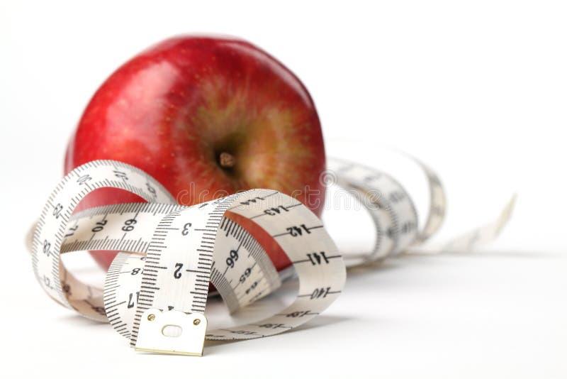 Misura e mela di nastro immagini stock