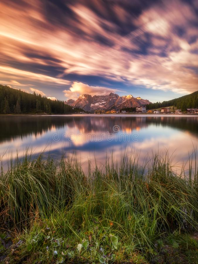 Misurina Lake, on Dolomites (Italian Alps) seen at sunrise. Sorapiss mountain in the background. South Tyrol, Dolomites, Italy. royalty free stock images