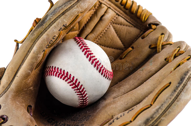 Mitón y bola del juego de béisbol imagen de archivo libre de regalías