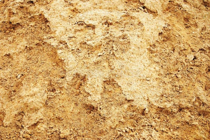 Mit gelbem Sand Beschaffenheit stockbilder