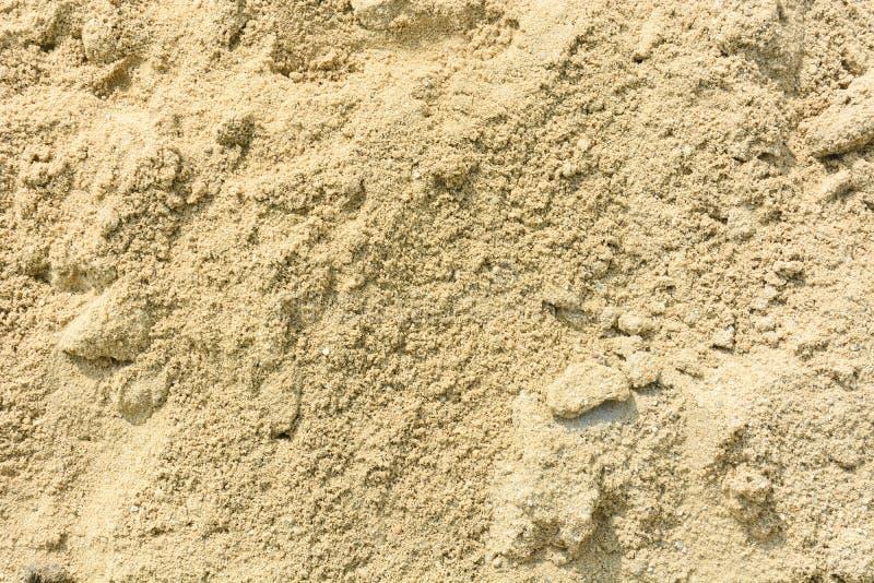 mit gelbem Sand f?r Baubeschaffenheitshintergrund stockbild