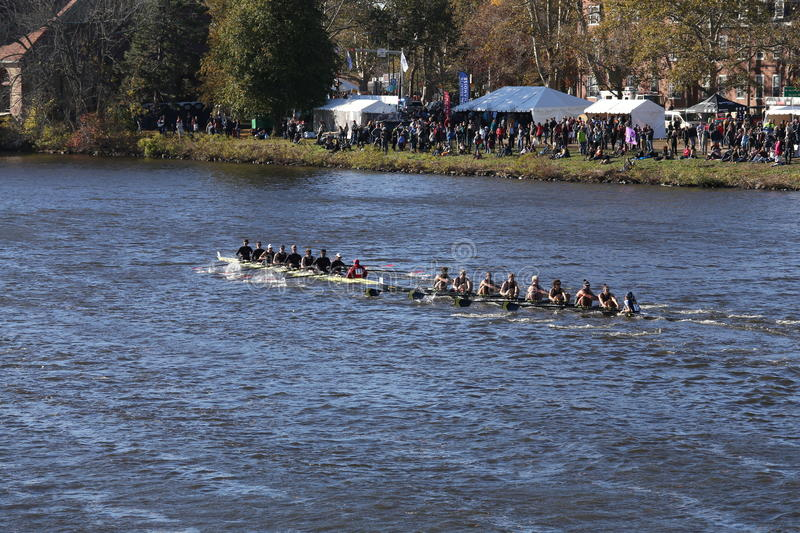 MIT races in the Head of Charles Regatta Men's College EightsMichigan (right) and Wesleyan (left). BOSTON - OCTOBER 22, 2016: Michigan (right) and Wesleyan (left royalty free stock images