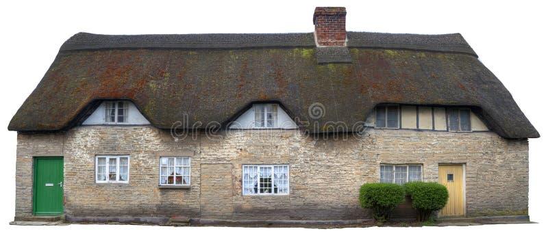 Mit Stroh gedeckte Häuschen, England stockbilder