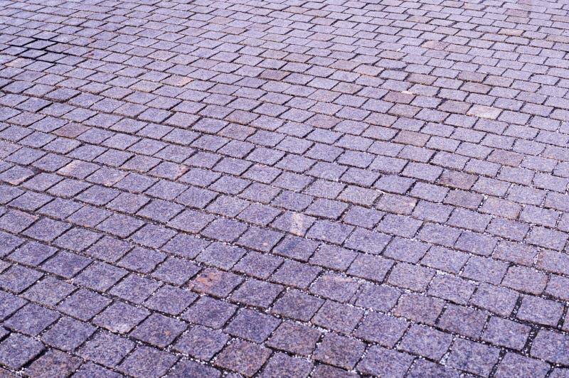 Mit Ziegeln gedeckter B?rgersteig mit Perspektivenansicht Hintergrund, st?dtisch lizenzfreies stockfoto