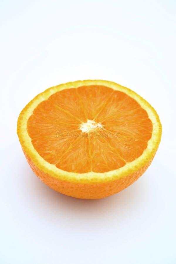 Mitad anaranjada imagenes de archivo