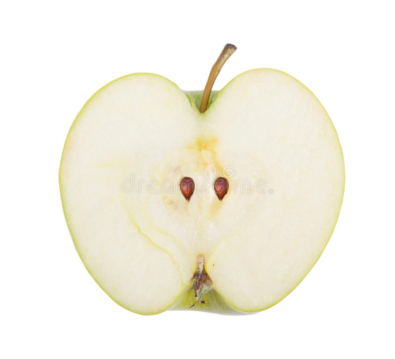 Mitad de la manzana verde imagen de archivo libre de regalías