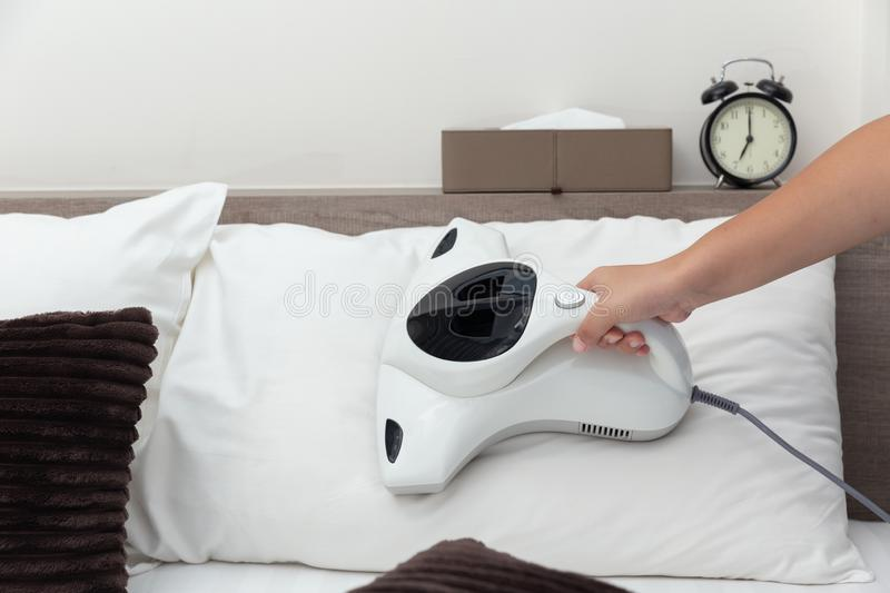 Mite vacuum cleaner using cleaning pillow bed mattress. Dust eliminator royalty free stock photo