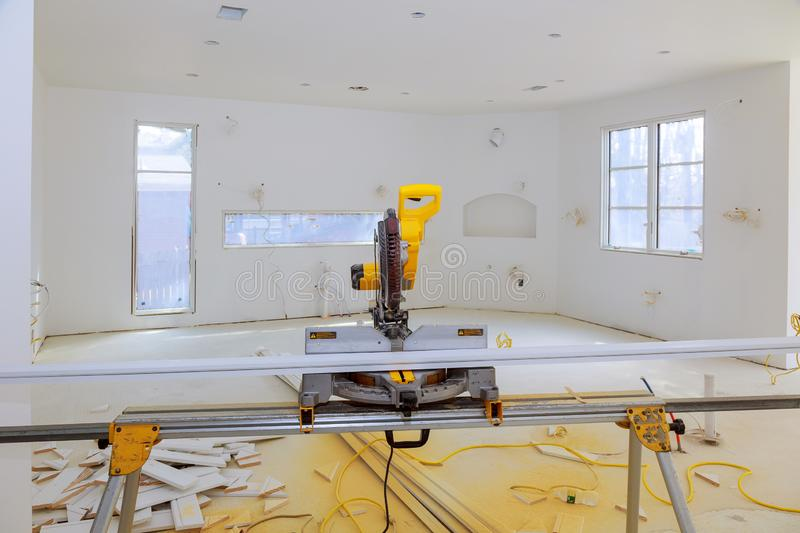 Miter Saw on a construction site with in contractor uses a circular saw to cut and trim. Contractor uses a circular saw to cut trim molding saw on a construction stock photos