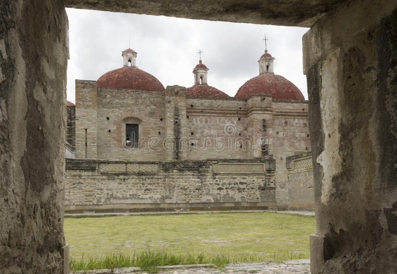 Mitla. Archaeological zone of Mitla, in the background, church built during conquest of Mexico. State of Oaxaca royalty free stock photos