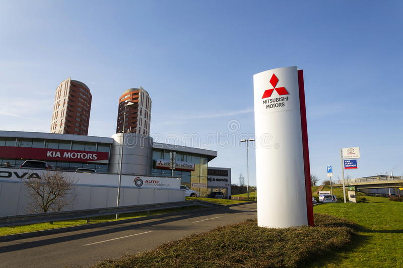 Mitsubishi motors company logo in front of dealership building on March 31, 2017 in Prague, Czech republic. PRAGUE, CZECH REPUBLIC - MARCH 31: Mitsubishi motors stock photos