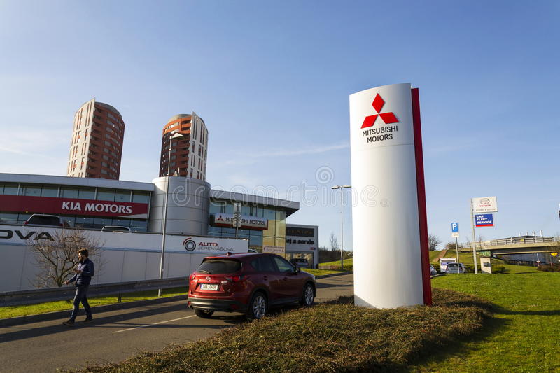Mitsubishi motors company logo in front of dealership building on March 31, 2017 in Prague, Czech republic. PRAGUE, CZECH REPUBLIC - MARCH 31: Mitsubishi motors royalty free stock photography