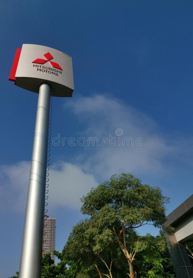 Mitsubishi Motors sign soars into blue sky. On September 24, 2019 in Pakkret, Nonthaburi, Thailand royalty free stock photos
