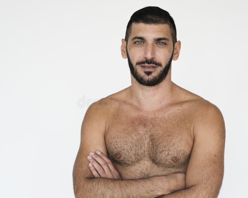 Mitt - för bröstkorgstudio för östlig man kal stående arkivfoton
