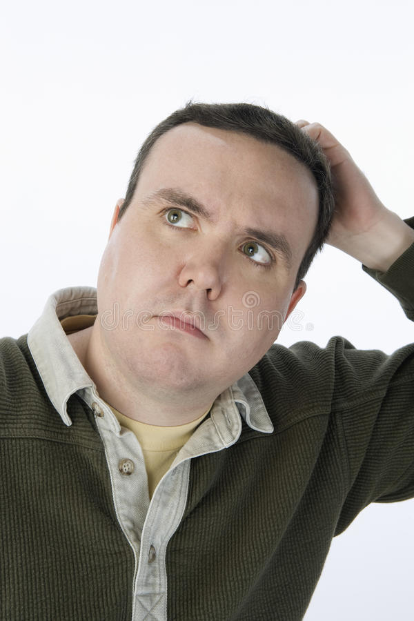 Mitte gealterter Mann, der Kopf verkratzt lizenzfreies stockbild