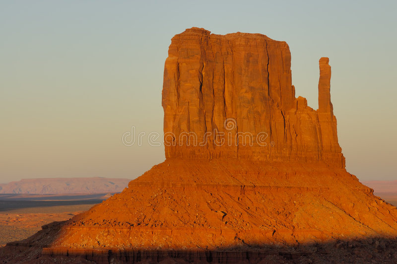 Mitten at Sunset. A closer view at Mitten Meas glowing bright orange-red in setting sun in Monument Valley (Navajo Nation royalty free stock photo