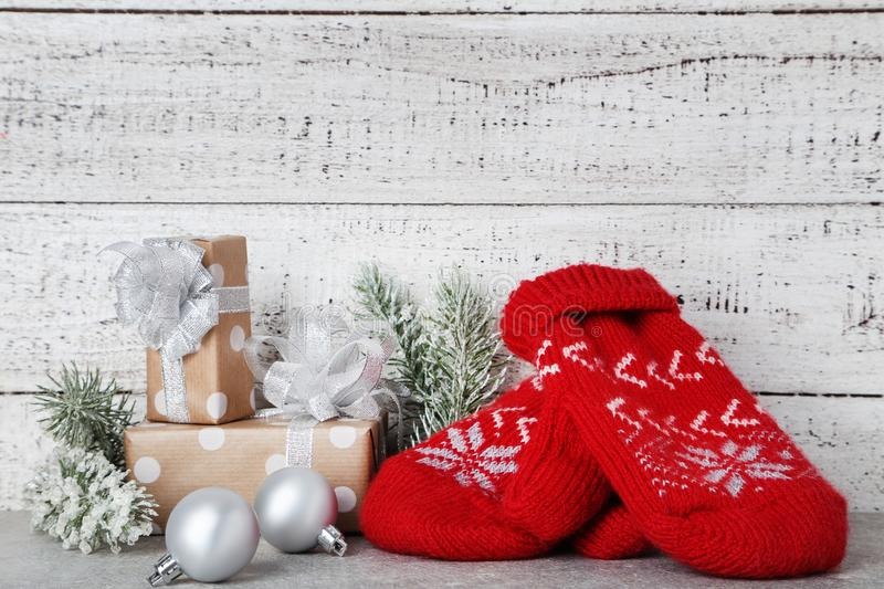 Mittens with gift boxes, fir tree branches royalty free stock photos