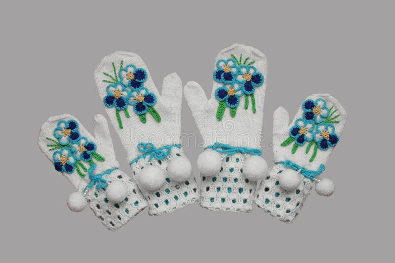 Mittens knitted from white yarn royalty free stock photo