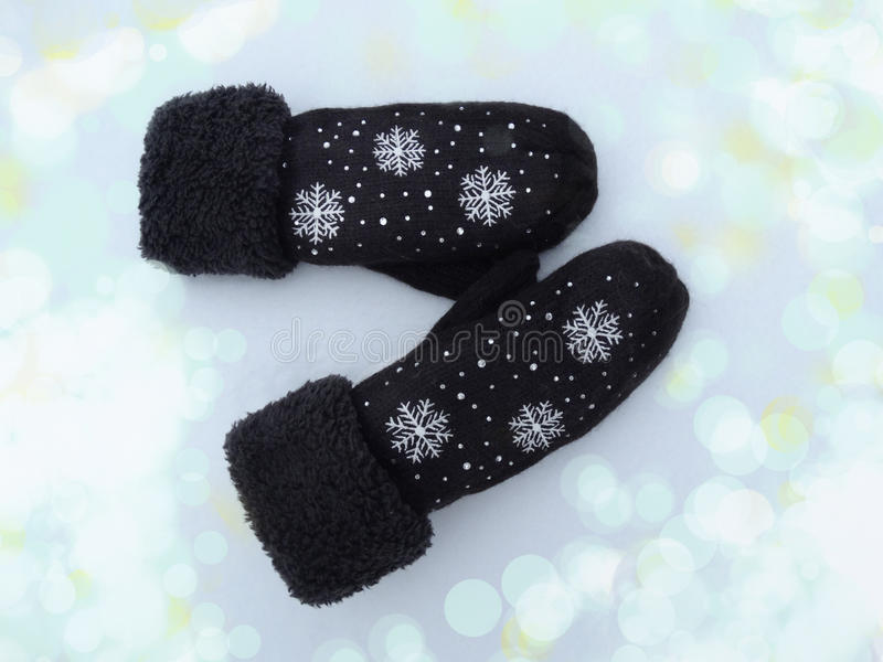 Download Mittens Winter Clothes On Snow Background Stock Photo - Image: 83701709