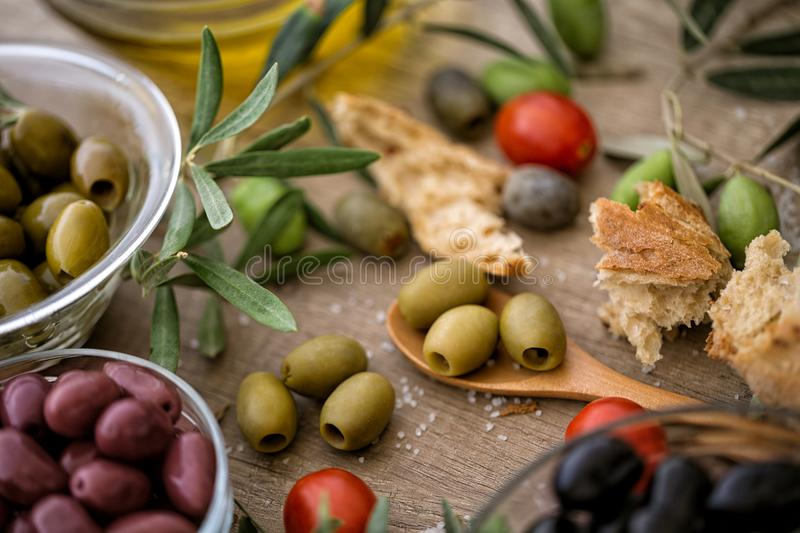 Mix of assorted whole Greek olives for snack. Background royalty free stock photography