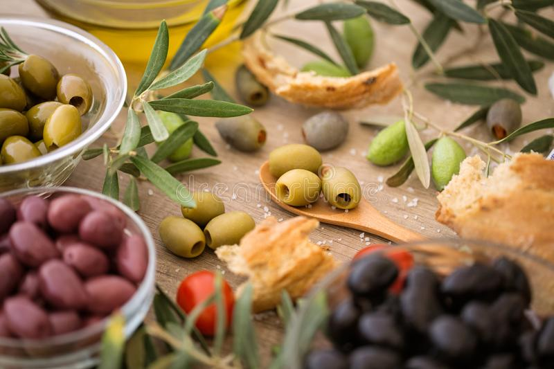 Mix of assorted whole Italian olives for snack. Background royalty free stock photography